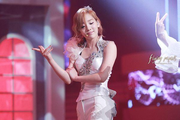 Tags: K-Pop, Girls' Generation, The Boys, Kim Tae-yeon, White Pants, Tiara, White Outfit, Crown, Medium Hair, Eyes Closed, Flying Petals