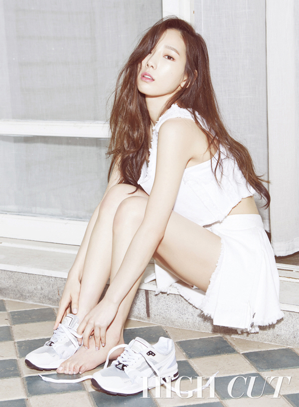 Tags: K-Pop, Girls' Generation, Kim Tae-yeon, Sitting On Ground, Text: Magazine Name, Covering Eyes, White Skirt, Shoes, Checkered Floor, White Footwear, Sneakers, Bare Legs