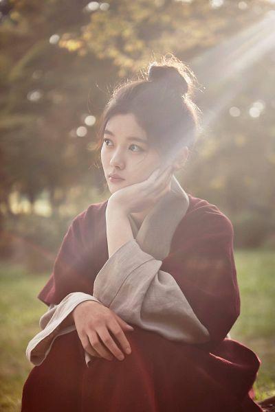 Tags: K-Drama, Kim Yoo-jung, Hand On Cheek, Tree, Serious, Single Bun, Plant, Hair Buns, Hand On Head, Hair Up, Grass, Red Outfit