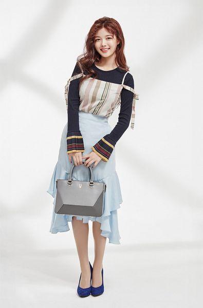 Tags: K-Drama, Kim Yoo-jung, Blue Footwear, Holding Object, Light Background, Wavy Hair, Multi-colored Shirt, Blue Skirt, High Heels, Bag, Skirt, Lapalette