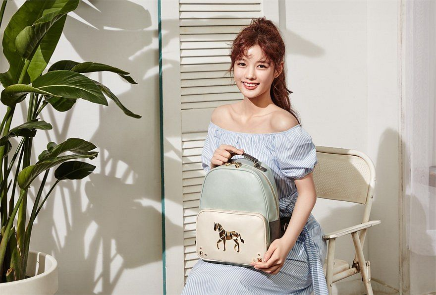 Tags: K-Drama, Kim Yoo-jung, Blue Outfit, Wavy Hair, Plant, Short Sleeves, Shadow, Holding Object, Blue Dress, Light Background, Bag, Backpack