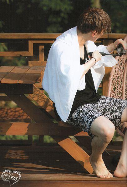 Tags: K-Pop, Got7, Kim Yugyeom, Bent Knees, Sitting, Barefoot, Wet, Black Shirt, Shorts, Wet Hair, Table, Scan