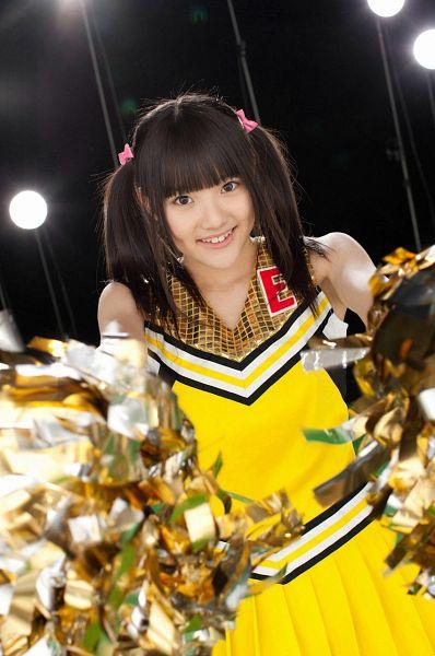 Tags: J-Pop, SKE48, Kimoto Kanon, Cheerleader, Bare Shoulders, Pom Poms, Sleeveless Dress, Black Background, Uniform, Dark Background, Yellow Dress, Twin Tails