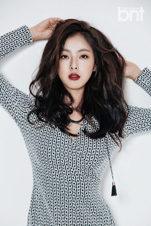 Tags: K-Drama, Ko Won-hee, Spotted Dress, Red Lips, Wavy Hair, Arms Up, Necklace, Black Eyes, Light Background, Spotted, Serious, White Background