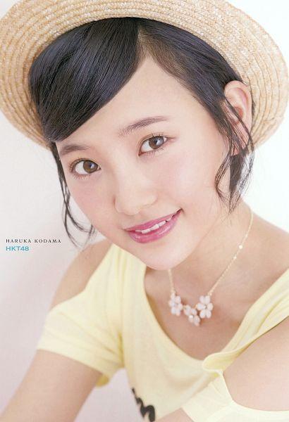 Tags: J-Pop, HKT48, AKB48, Kodama Haruka, Light Background, White Background, Necklace, Brown Headwear, Yellow Shirt, Hat, Text: Artist Name, Hair Up