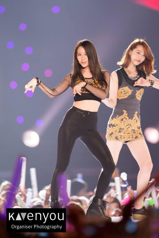Tags: K-Pop, f(x), Sulli, Krystal Jung, High Heels, Black Footwear, Black Pants, Bracelet, Dark Background, Pointing, Boots, Black Background