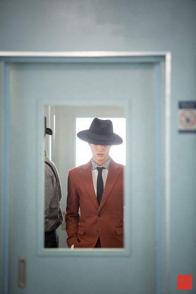 Tags: K-Drama, Kwak Dong-yeon, Train, Jacket, Short Hair, Door, Hat, Orange Outerwear, Hand In Pocket, Tie, Standing, Mobile Wallpaper