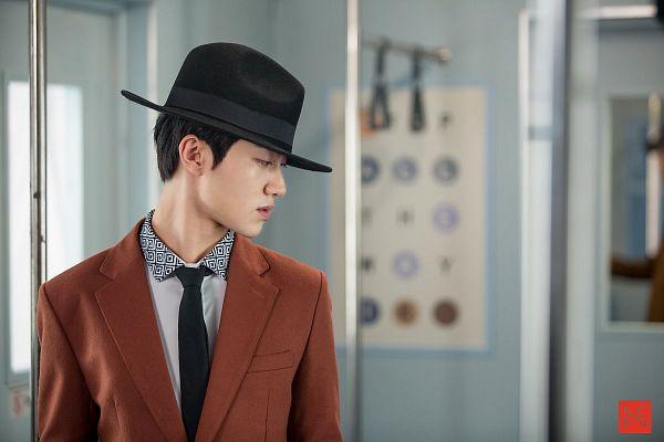 Tags: K-Drama, Kwak Dong-yeon, Orange Outerwear, Jacket, Short Hair, Train, Hat, Tie, Standing