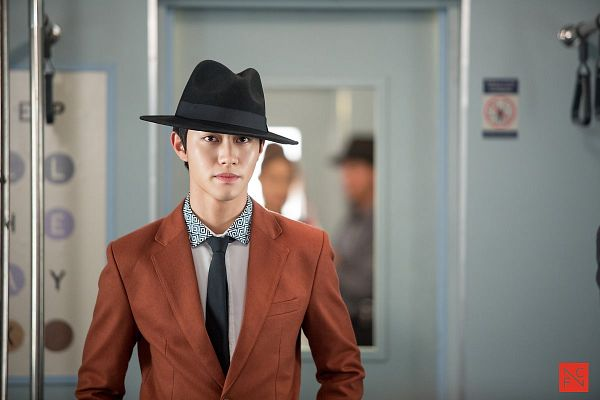 Tags: K-Drama, Kwak Dong-yeon, Hat, Tie, Standing, Orange Outerwear, Jacket, Short Hair, Train