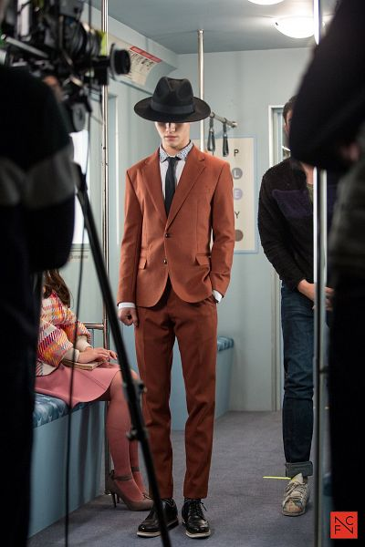Tags: K-Drama, Kwak Dong-yeon, Short Hair, Orange Outerwear, Full Body, Hat, Hand In Pocket, Tie, Train, Standing, Orange Pants, Jacket