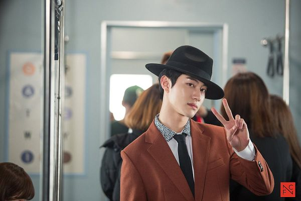 Tags: K-Drama, Kwak Dong-yeon, Jacket, V Gesture, Train, Short Hair, Hat, Standing, Tie, Orange Outerwear