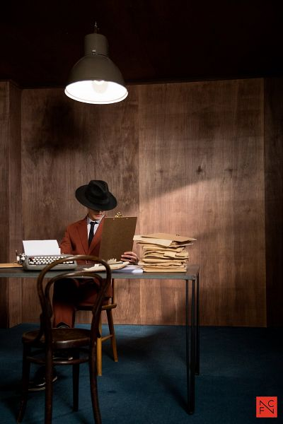 Tags: K-Drama, Kwak Dong-yeon, Typewriter, Tie, Lamp, Chair, Table, Orange Outerwear, Sitting On Chair, Hat, Android/iPhone Wallpaper