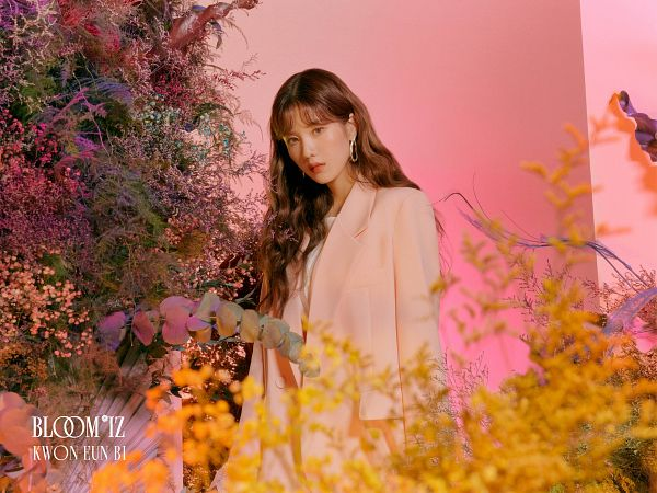 Tags: K-Pop, IZ*ONE, Kwon Eunbi, Pink Outerwear, Pink Jacket, Text: Artist Name, Yellow Flower, Text: Album Name, Serious, Flower, Plant