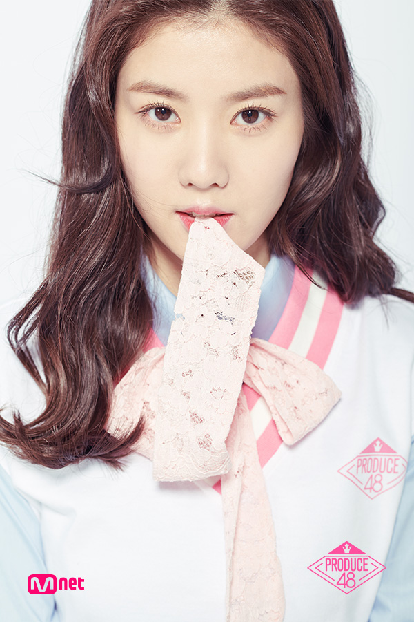 Tags: Television Show, K-Pop, Kwon Eunbi, Close Up, Sweater, Light Background, Collar (Clothes), White Background, Blue Shirt, Wavy Hair, Text: Series Name, Bow Tie