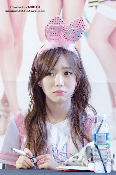 Tags: K-Pop, AOA (Ace Of Angels), Kwon Mina, Nail Polish, Ring, Water, Korean Text, Pink Headwear, Looking Away, Pen, Bottle, Text: Artist Name