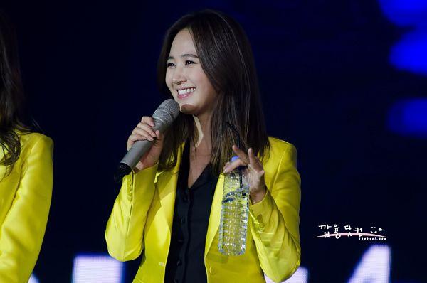 Tags: K-Pop, Girls' Generation, Kwon Yuri, Bottle, Black Background, Yellow Outerwear, Water, Matching Outfit, Dark Background, Kkabyul