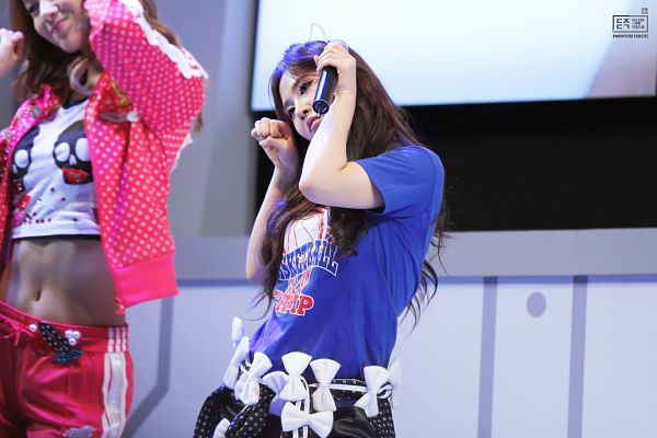Tags: K-Pop, Girls' Generation, Dancing Queen, Kwon Yuri, Pink Jacket, Blue Shirt, Bow, Fist, From Below, White Bow, Midriff, Animal Ears