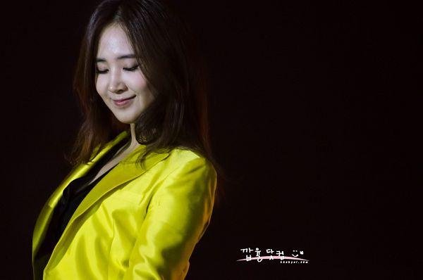 Tags: K-Pop, Girls' Generation, Kwon Yuri, Eyes Closed, Yellow Outerwear, Dark Background, Black Background, Kkabyul