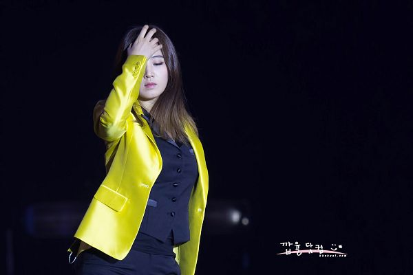 Tags: K-Pop, Girls' Generation, Kwon Yuri, Black Pants, Yellow Outerwear, Hand In Hair, Dark Background, Eyes Closed, Black Background, Kkabyul