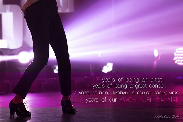 Tags: K-Pop, Girls' Generation, Kwon Yuri, Text: Artist Name, Black Pants, Black Footwear, English Text, Korean Text, Purple Background, High Heels, Face Cut Off, Kkabyul