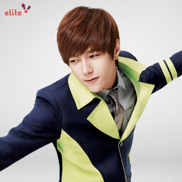 Tags: K-Pop, Infinite, L, Tie, Looking Down, Striped Shirt, Gray Neckwear, Black Jacket, Looking Away, Text: Brand Name, Gray Background, School Uniform