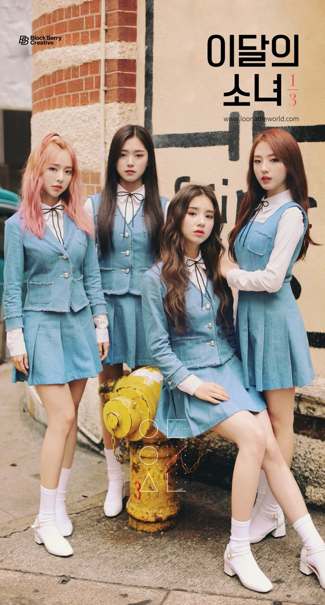 Tags: K-Pop, LOOΠΔ, Jo Haseul, Kim Hyunjin, Vivi (LOOΠΔ), Text: URL, Blue Jacket, Skirt, Hand On Shoulder, Text: Artist Name, English Text, Blue Skirt