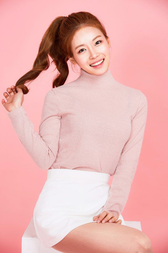 Tags: K-Pop, ICIA, Lee Bo-ra, Pink Background, Pink Shirt, Head Tilt, Sweater, Hair Up, White Skirt, Ponytail, Turtleneck, Collar (Clothes)