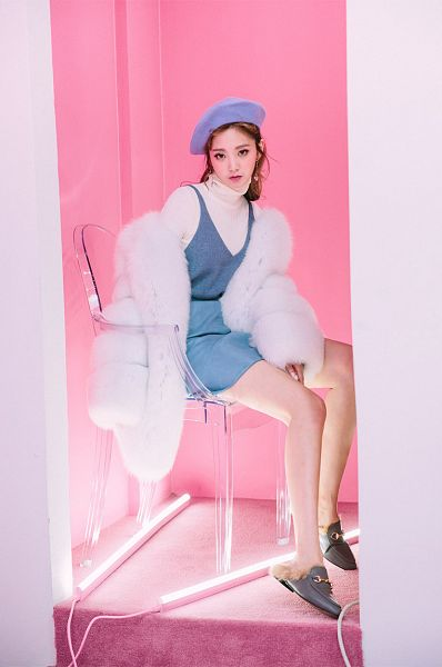 Tags: Fashion, Lee Chaeeun, Fur Trim, Wavy Hair, Pink Background, Sitting On Chair, Contact Lenses, Hat, Blue Skirt, Shoes, Slippers, Skirt