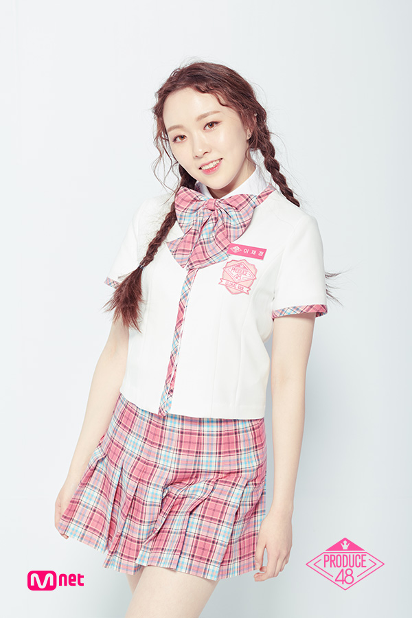 Tags: K-Pop, Television Show, Lee Chaejeong, Bow Tie, Korean Text, Twin Braids, Contact Lenses, Skirt, Collar (Clothes), Checkered Neckwear, Close Up, Text: Artist Name