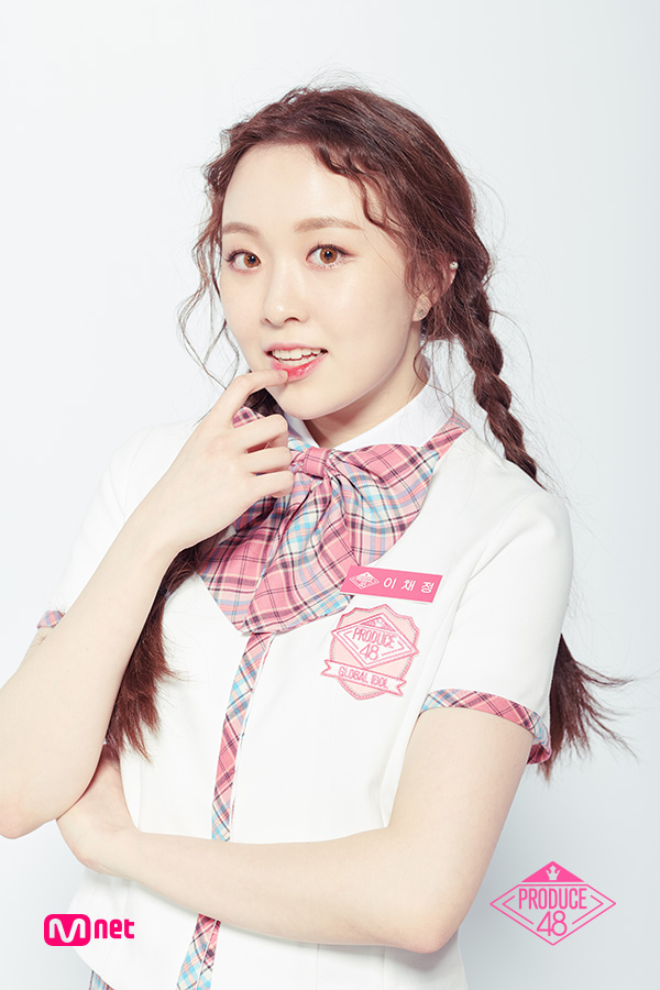 Tags: Television Show, K-Pop, Lee Chaejeong, White Background, Korean Text, Finger To Lips, Bow Tie, Collar (Clothes), Twin Braids, Contact Lenses, Short Sleeves, Close Up
