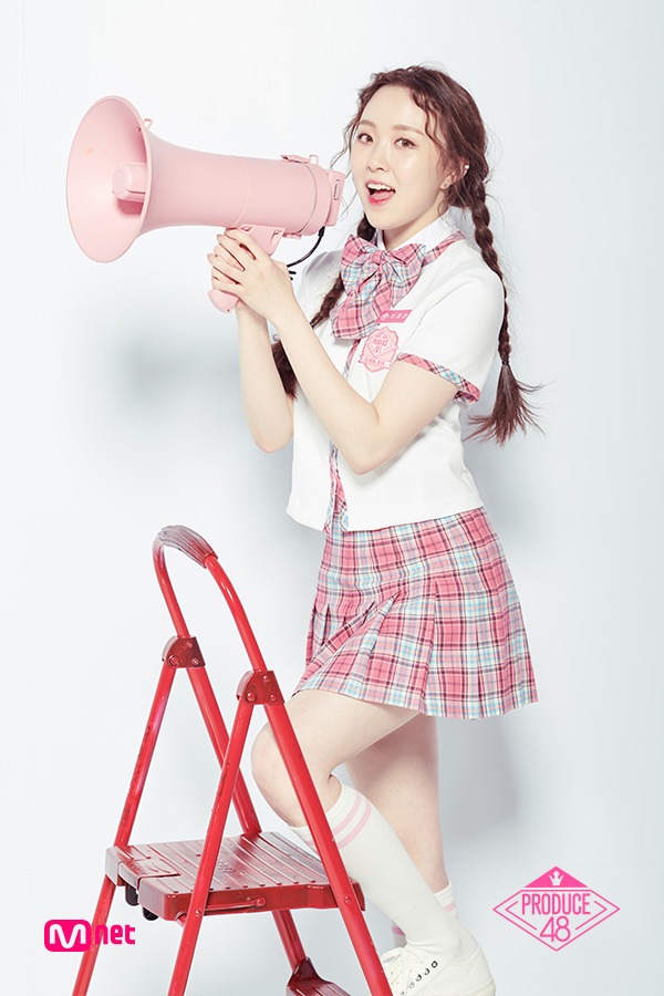Tags: K-Pop, Television Show, Lee Chaejeong, Ladder, White Footwear, Shoes, Pink Skirt, Contact Lenses, Holding Object, Stairs, Checkered Neckwear, Bow Tie