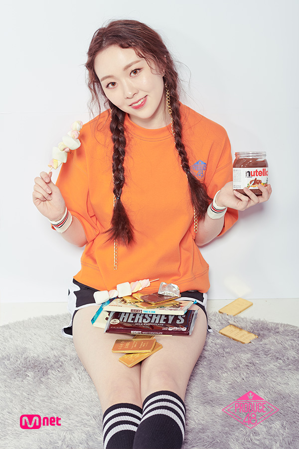 Tags: K-Pop, Television Show, Lee Chaejeong, Shorts, Braids, Sweets, Twin Braids, Contact Lenses, Thigh Highs, Orange Shirt, Light Background, Sitting On Ground