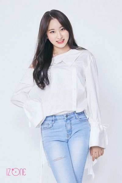 Tags: K-Pop, IZ*ONE, Lee Chaeyeon, Text: Artist Name, White Background, Blue Pants, Hand On Hip, Black Eyes, Jeans, Light Background