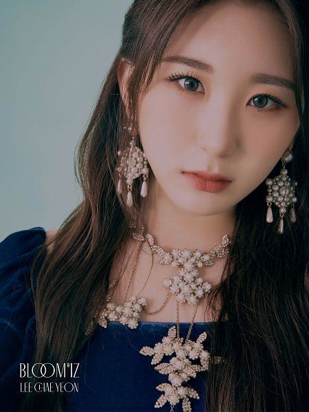 Tags: K-Pop, IZ*ONE, Lee Chaeyeon, Text: Artist Name, Text: Album Name, Necklace, Serious, Blue Background, Blue Shirt