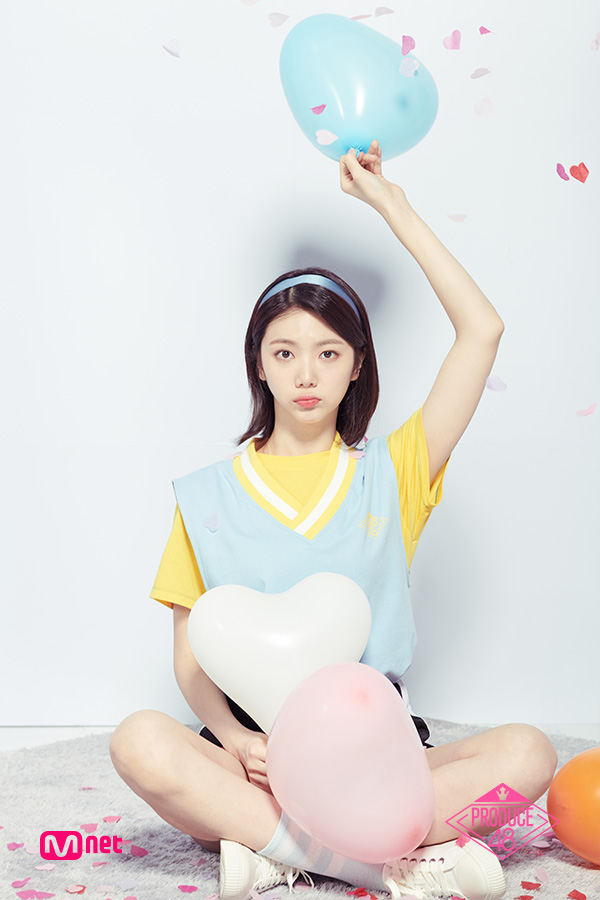 Tags: Television Show, K-Pop, After School, Lee Gaeun, Yellow Shirt, Sneakers, Crossed Legs, Socks, Arms Up, White Footwear, Holding Object, Sweater