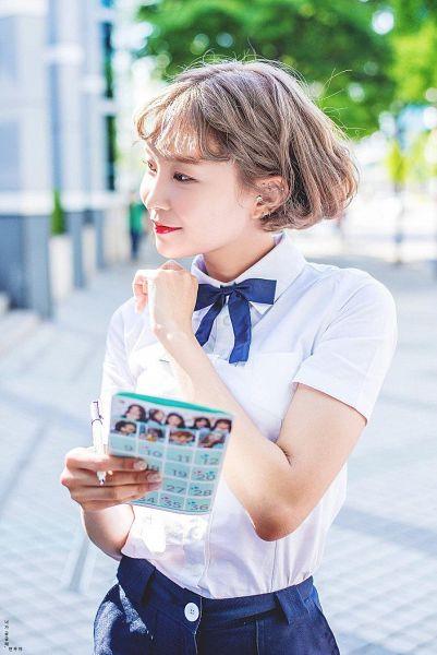 Tags: K-Pop, Momoland, Lee Hyebin, Blue Bow, Looking Away, Bow, School Uniform, Outdoors, Blue Neckwear, Uniform, Blue Skirt, Skirt