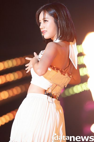 Tags: K-Pop, Girls' Day, Lee Hyeri, Medium Hair, Bare Back, Looking Up, Skirt, Back, Black Background, Hand On Chest, Dark Background, Midriff