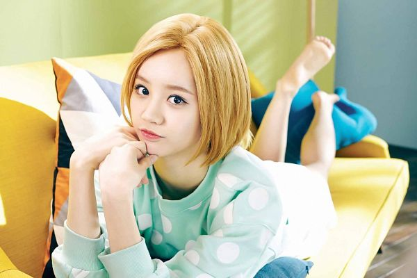 Tags: K-Pop, Girls' Day, Lee Hyeri, Blue Shirt, Laying Down, Medium Hair, Chin In Hand, Couch, Spotted Shirt, Laying On Stomach, Laying On Couch, Skirt