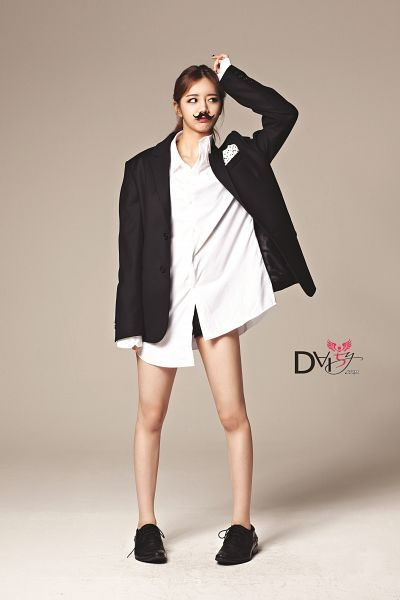 Tags: Girls' Day, Lee Hyeri, Black Shorts, Hand On Head, Black Jacket, Brown Background, Looking Away, Black Footwear, Shorts, Mustache, Android/iPhone Wallpaper