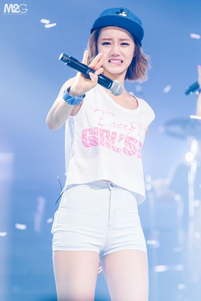 Tags: K-Pop, Girls' Day, Lee Hyeri, Blue Headwear, Wave, Bare Shoulders, Blue Background, Shorts, Bare Legs, Hat, Confetti, Crying