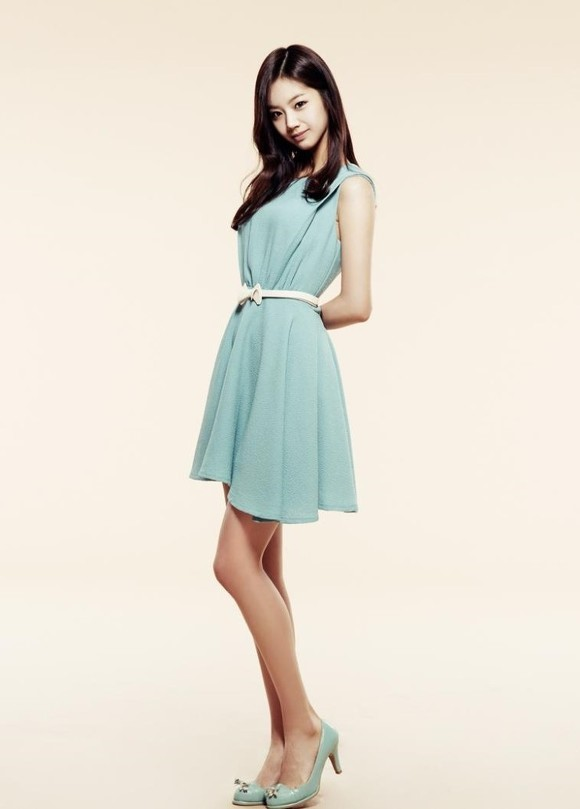 Tags: K-Pop, Girls' Day, Lee Hyeri, Blue Outfit, Blue Footwear, Yellow Background, Bare Legs, Belt, Arms Behind Back, Blue Dress, High Heels