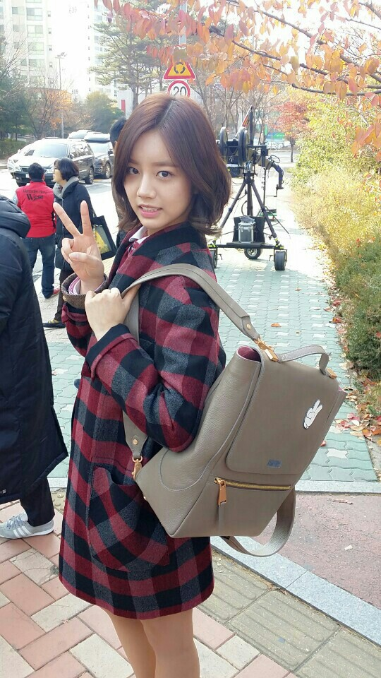 Tags: K-Pop, Girls' Day, Lee Hyeri, Bag, Outdoors, Medium Hair, Red Outerwear, Bare Legs, Backpack, Checkered, Red Jacket, V Gesture
