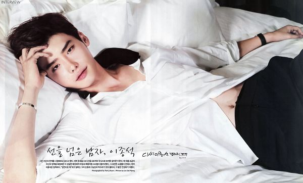 Tags: K-Drama, Lee Jong-suk, Navel, Midriff, Laying On Back, Korean Text, Black Pants, Hand In Hair, On Bed, Looking Up, Laying Down, Bed