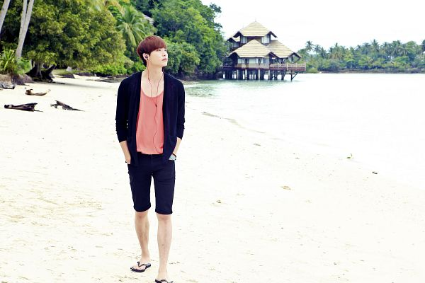Tags: K-Drama, Lee Jong-suk, Looking Away, Bracelet, Sandals, Shoes, Bare Legs, Orange Shirt, Earbuds, Shorts, Water, Outdoors