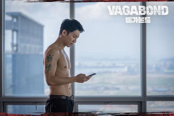 Tags: K-Drama, Lee Seung-gi, Smartphone, Side View, Looking at Phone, Abs, Belt, Shirtless (Male), Tattoo, Phone, Window, Black Pants