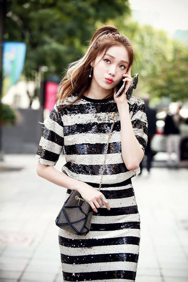 Tags: K-Drama, Lee Sung-kyung, Looking Away, Silver Dress, Bag, Outdoors, Phone, Ring, Glasses, Pouting, Striped Dress, Sunglasses
