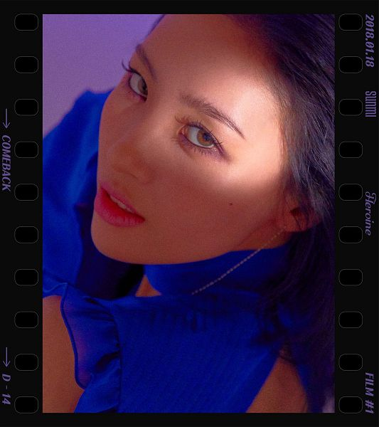Tags: MAKEUS Entertainment, K-Pop, Heroine, Lee Sunmi, Text: Artist Name, English Text, Purple Background, Text: Song Title, Blue Shirt, Text: Calendar Date, Close Up