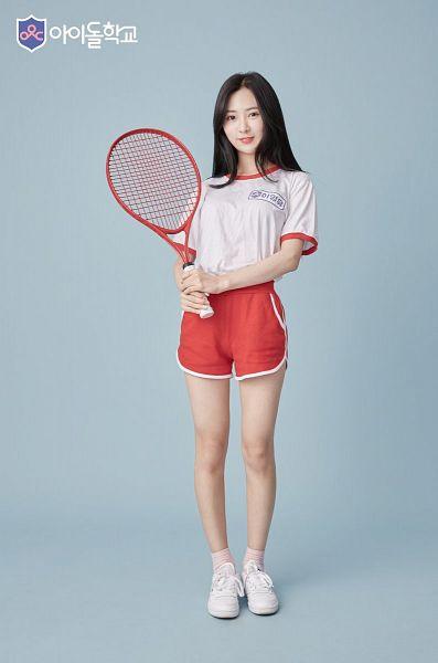 Tags: Television Show, K-Drama, Lee Young-yoo, White Footwear, Korean Text, Orange Shorts, Short Sleeves, Bloomers, Tennis Racket, Blue Background, Tennis, Idol School