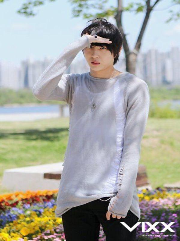 Tags: K-Pop, VIXX, Leo, Black Pants, Outdoors, Text: Artist Name, Gray Shirt, Ring, Necklace