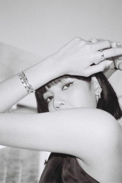 Tags: K-Pop, Black Pink, Lisa, Ring, Back, Medium Hair, Bare Shoulders, Looking Down, Monochrome, Covering Mouth, Black Eyes, Bracelet